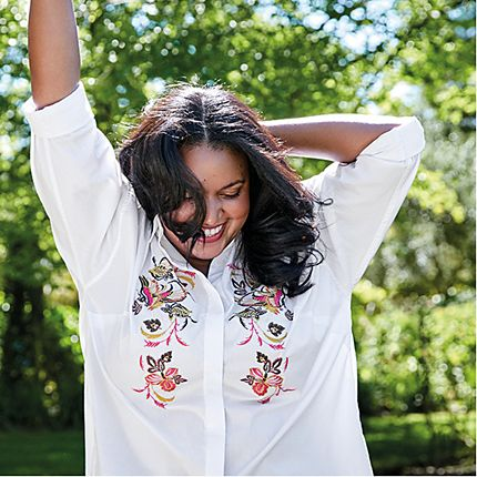 Model wearing a floral-embroidered white shirt from the Curve collection