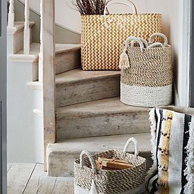 Woven storage baskets on stairs