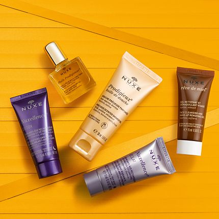 Nuxe skin-care minis on a yellow background
