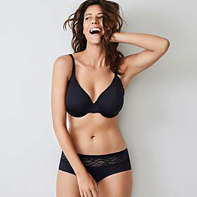 Woman wearing black Smoothlines bra and knickers