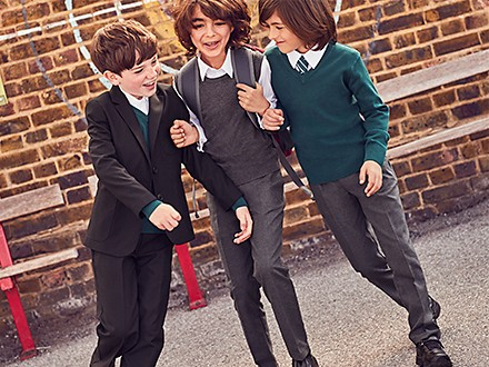 Boy jumping wearing M&S trousers