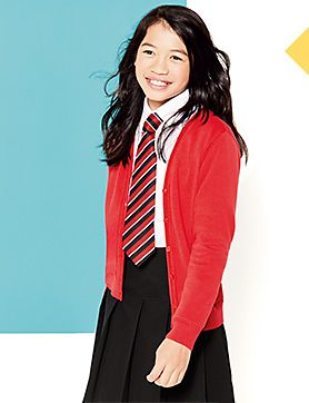 A girl wearing a red cardigan and black skirt with a school tie