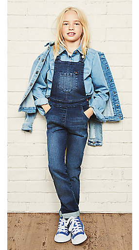 Girl in denim dungarees and denim jacket