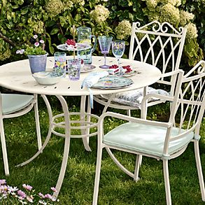 A garden table and chairs from the garden furniture range