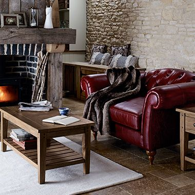 Red leather armchair with fur throw and wooden coffee table