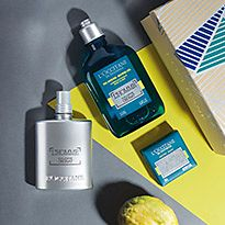 L'Occitane men's grooming products on a graphic grey and yellow background