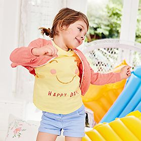 Girl wearing yellow T-shirt, blue shorts and a pink hoody