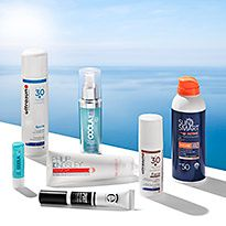 Collection of sunscreens on a pool edge