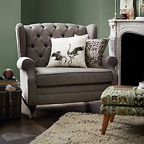 Sofa, footstool and fireplace