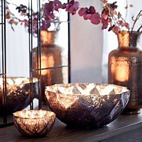 Candles in metal bowls