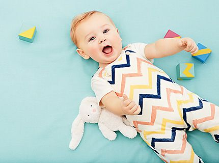 Baby in printed babygro