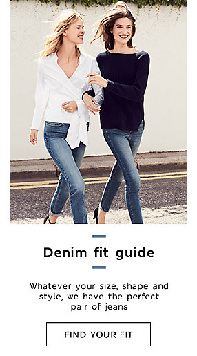 Two women wearing jeans