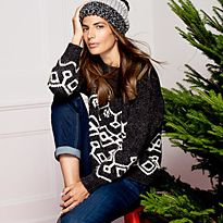 Woman wearing Christmas jumper and bobble hat