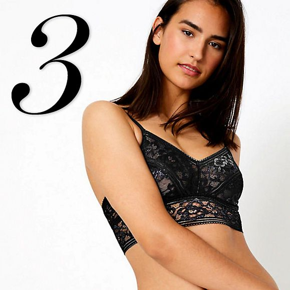 Model wearing Louisa Lace longline bralette in black