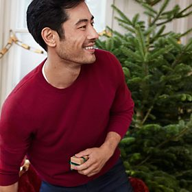 Man wearing red cashmere jumper