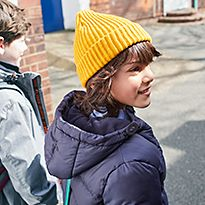 Boy wearing yellow beanie and padded M&S school coat
