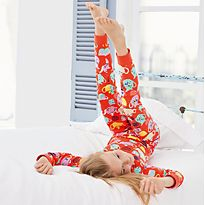 Girl on bed wearing M&S pyjamas