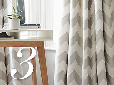 Chevron-patterned floor-length curtains