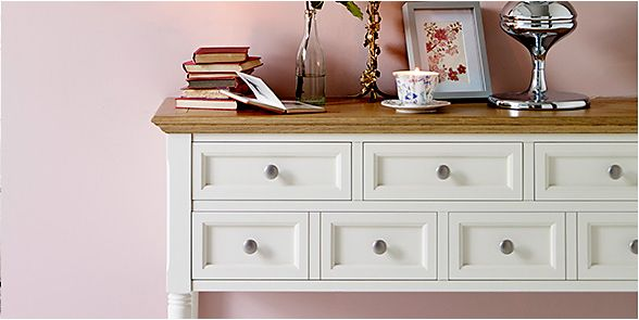 A sideboard with drawers