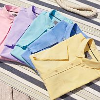 Men's short sleeve shirts laid on decking