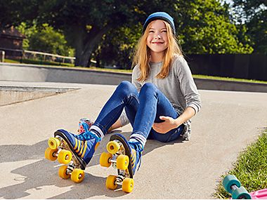 Girl in jeans on roller skates