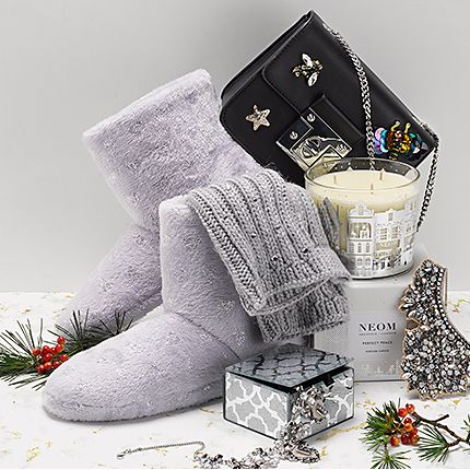 Selection of accessories, including slippers, jewellery, a bag and candle