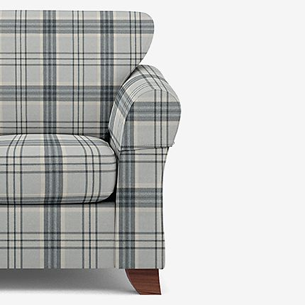 Checked armchair with armcaps