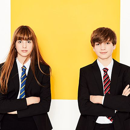 Teenage boy and girl in uniform