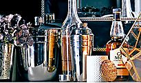 Home bar with cocktail shaker and bottles