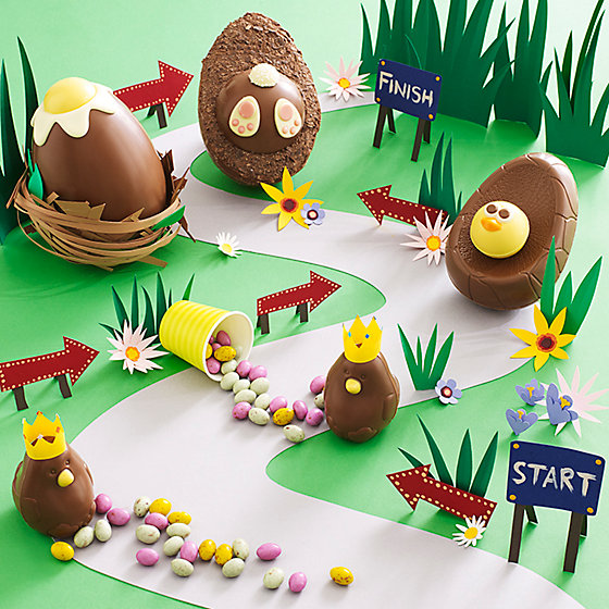 Brilliant easter eggs for kids a variety of novelty easter eggs set out on an egg hunt pathway made of paper negle Gallery