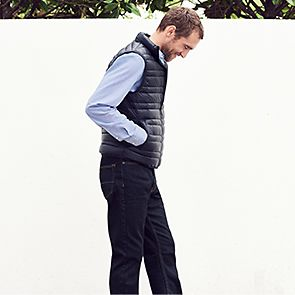 Man wearing jeans and gilet