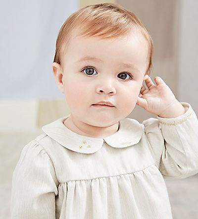 Baby in luxury Marie-Chantal dress