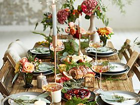 Christmas party table laid with gluten free and vegetarian food
