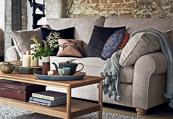 Cushions and throws on a grey sofa