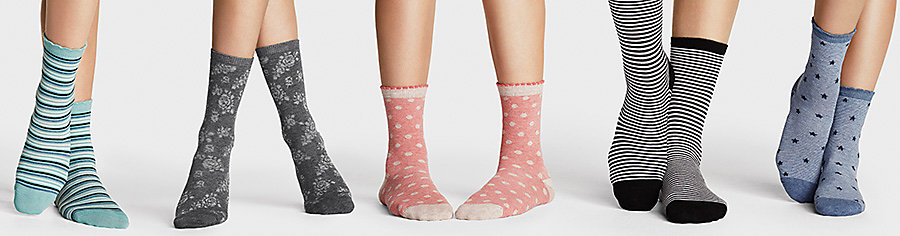 Five pairs of legs with different socks on