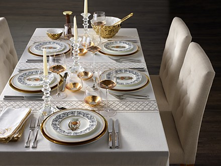 Safari plates, Nouveau plates and Bellagio gold glasses on a dining table