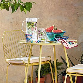 Yellow metal garden table and chairs