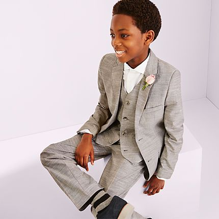 Boy dressed in wedding suit