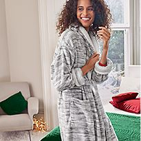 Woman wearing grey shimmer borg-trim dressing gown