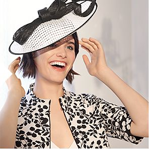 Woman wearing white fascinator hat
