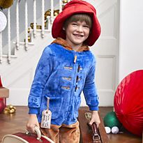 Boy wearing Paddington fancy dress costume