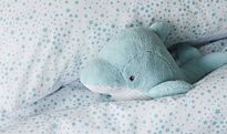 Children's bedding with a soft toy