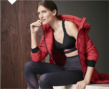 Model wears red padded jacket, sports bra and ombre leggings