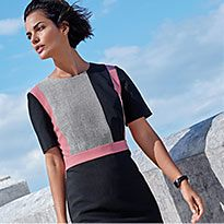 Woman wearing navy, grey and pink colour-block work dress