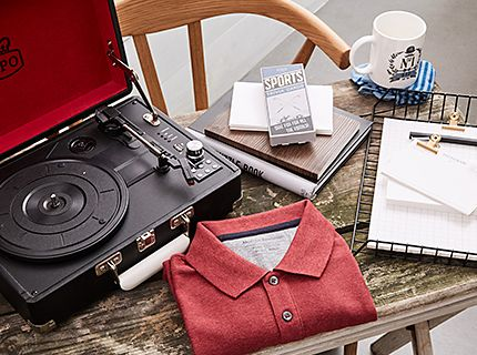 Assorted mens gifts including record player, polo shirt and books