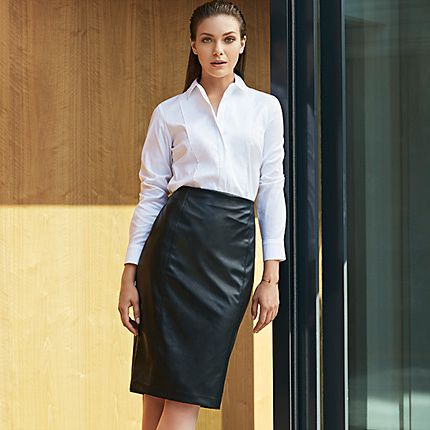 Model in shirt and leather skirt