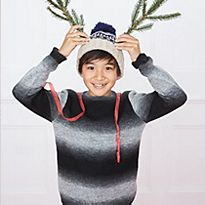 Boy in a Christmas hat and jumper
