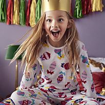 Girl wearing gold paper crown and M&S pyjamas