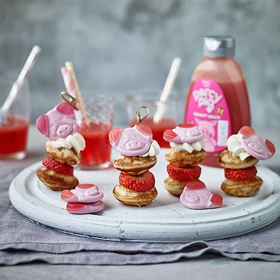 Mini pancake and strawberry stacks with Percy Pig dessert sauce