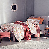 Bed with patterned bedding